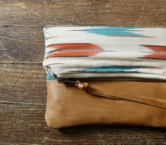 fold over zipper pouch, fabric and leather