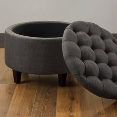 Class up any room with this Sasha Dum Dum charcoal ottoman. Functionality and style collide with this round cocktail ottoman in the form of extra seating for guests and extra storage space that is eas