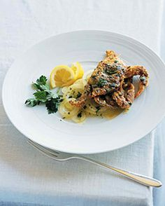 Soft-Shell Crabs with Sliced Sweet Onion | Martha Stewart Living - These in-season crabs need a quick buttermilk brine before being coated in a super-crisp coating of seasoned cornmeal and flour and fried to perfection. Serve them on a bed of sweet-onion salad.