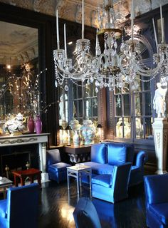 Thomas Britt: classical interior anchored by glossy contemporary blue seating.