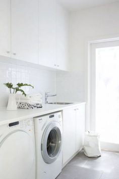 LAUNDRY: underbench appliances (2x washers) + sink + overhead cabinetry + broom cupboard (with power)
