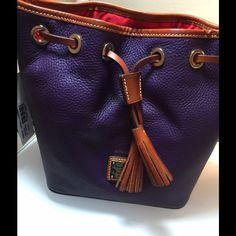 NWT Dooney Purple Drawstring bucket Bag Brand New D&B Purple Leather Handbag. 9 X 9 X 6 there are feet on bottom Dooney & Bourke Bags Totes