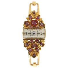 Circa 1941 Cartier Ladies Yellow Gold Ruby Set Wristwatch. $50,302.  | From a unique collection of vintage wrist watches at https://www.1stdibs.com/jewelry/watches/wrist-watches/
