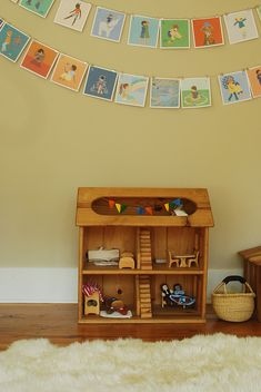 a child's room—invitation for imaginative play, creativity, and restful sleep...the warmth of the wood, soft but cheerful color, sunlight, natural materials...full of loveliness