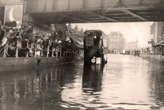 A photo showing the almost annual flooding under Silver Street railway bridge, Edmonton, north London, about 1920