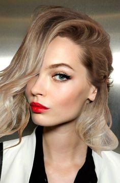Red lipstick; Cat eyeliner; Blonde hair