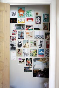 Toilet wall with miscellaneous postcards and photos - I could easily do this on our toilet door!