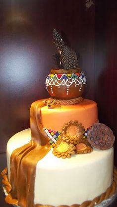 Adorable African Wedding Cake Ideas That You Will Love For Your Inspirations - How to plan an African Inspired Wedding on a Budget Many African American couples like the idea of incorporating their heritage into their wedding nup. Zulu Traditional Wedding, Traditional Cakes, Wedding Cake Images, Wedding Cake Designs, Themed Wedding Cakes, Wedding Cake Decorations, Wedding Ideas South Africa, Profiteroles, Croquembouche