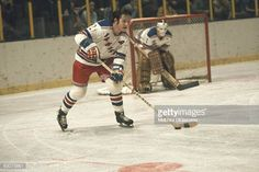 Canadian ice hockey player Brad Park of the New York Rangers skates with the puck during a game, late or early Goalie Ed Giacomin is visible in the background. Get premium, high resolution news photos at Getty Images Brad Park, Ice Hockey Players, New York Rangers, Nhl, Kicks, Skates, Sports, Beauty, Awesome