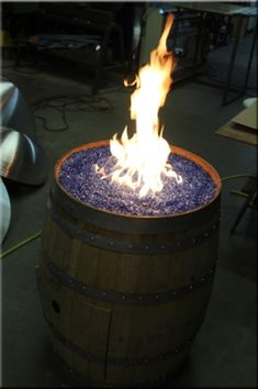 Wine barrel fire pit maybe this would work better than that stupid well pit hahaha
