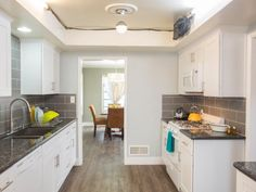 Design a kitchen in crisp white and gray, as seen here on hgtv.com, and give yourself plenty of room for bright and playful pops of color.