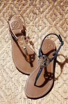 Absolutely love the shiny logo medallion on these Tory Burch metallic leather thong sandals.