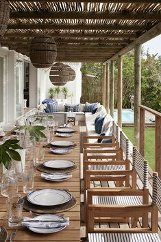 High on the mountainside overlooking Plettenberg Bay lagoon, Indigo House commands a spectacular view and boasts signature indigo, white and wood interiors. Wood Interiors, Rental Property, South Africa, Gazebo, Outdoor Living, Indigo, House, Outdoor Structures, Table Decorations