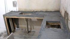 Bancada de cozinha construída em concreto armado aparente