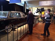 Former secret services agent Clint Hill looking at the car Kennedy was assassinated in