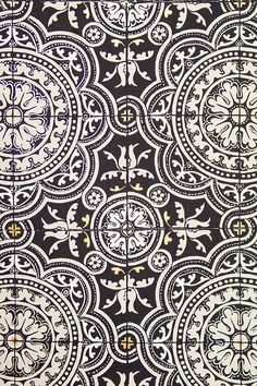 Piccadilly Wallpaper Stylish Turkish inspired tiled effect wallpaper in elegant black and white, The paper is further embellished with subtle gold and silver detail.