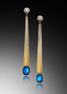 Rainbow moonstones of .22 carat total weight rest upon gradient Iris gold and 18kt gold in our Egyptian earrings. Iris gold is made by a signature hand-fabrication technique that yields a seamless gradient ranging from 22kt yellow to 9kt white. By Adam Neeley
