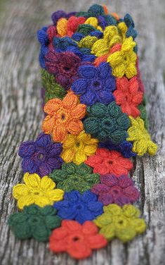 Puff stitch flowers crocheted scarf (link to video tutorial in comments). Add tassel for bag charm.