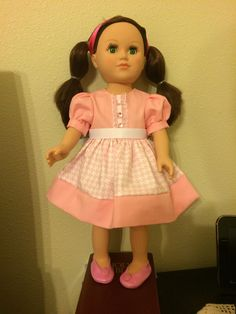 American Girl doll dress. Miss Little Bo peep Collection. Long pink and white hounds tooth design dress with short puffy sleeves and pink button accents.