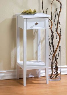 Willow White Side Table This slim accent table will fit in the narrowest of nooks to make it more functional. The single pullout drawer is highlighted by a brassy metal knob and the table features a lower shelf for additional storage. The white finish will brighten a dark corner, especially when topped with a table lamp!