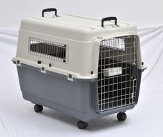 This carrier is 80cm*56.2cm*59cm. With one bowl, four wheels. 2 handles on top. With clips around the middle part, bolts have to attach top and bottom if you take it to the airplane. Metal door and window, robust and reliable !