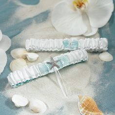 Starfish Garters for Beach Themed Wedding - This seaside influenced wedding garter set is accented with a tranquil water blue lining and studded with silver starfish. Ideal for beach themed weddings or weddings abroad. Fabric is 100% polyester. #WeddingDresses #WeddingRings #WeddingGifts #Wedding #WeddingIdeas