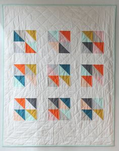 Handmade modern baby quilt in a sweet and cheerful geometric design made with custom colors of your choice. Choose from a range of contemporary colors that will be perfect for your little one. I use the highest quality cotton, with a wonderfully soft cotton backing fabric. * Measures 40 x 50 inches--a great size for a crib or toddler bed * 100% cotton * Machine pieced and quilted, with hand sewn binding * Backing fabric selected to complement the quilt top--plenty of fun prints to choose…