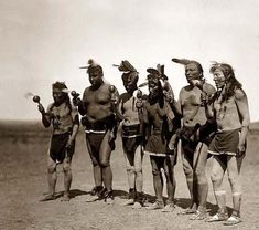 Above we show a dramatic photo of an Arikara Medicine Ceremony. It was made in 1908 by Edward S. Curtis.    The illustration documents Six Indians standing in line in front of cedar tree, holding rattles and singing.    We have compiled this collection of artwork mainly to serve as a vital educational resource. Contact curator@old-picture.com.