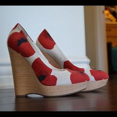 "Yves Saint Laurent Maryna Wedge Pumps White, red, and black floral print canvas shoes. Round tie and natural wood platform. 5.5"" heel and 1"" platform. (Also seen on Katie Holmes) Yves Saint Laurent Shoes Platforms"