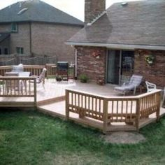 This custom designed pressure treated southern yellow pine deck was built on a ranch home therefore to achieve a level change you can only go up.  This multi-level approach allowed for a dedicated dining area and a general entertaining area.  Note the grilling station was part of the plan.