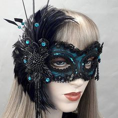 Lulu masquerade mask by Alexis Seepo - gorgeous teal color with black lace, feathers, and adorned with jewels