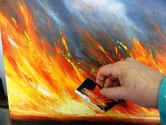 Putting the credit card to good use.  Australian artist Linda MacAulay shows how to paint in acylics using the credit card in this dynamic painting of fire.