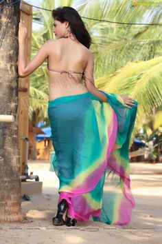 Keerthi: saree - check, bikini blouse - check, high heels - check, oomph - check. What's not to love?!