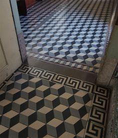 Azulejos on the walls, with encaustic tiles on the floor. 18th c. bold geometric patterns vs 2oth c. cubes and greek key borders. Faculdade de Ciências da Universidade de Coimbra, Coimbra