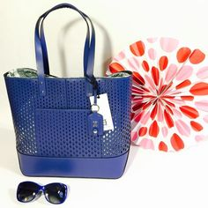 """😎OH by Joy Gryson Diamond Perf Tote Blueberry NWT. This beautiful sturdy beach-perfect tote features one large outer pocket and a snap in removable drawstring compartment (pic 4) that can be worn as a soft backpack. Tote is open top/no closure. Includes OH dustbag. Measures 16""""H x 13""""L x 4.5""""D. Handle drop is 9"""".  Cow leather exterior, polyester OH signature design interior. Paul Smith Sunglasses sold separately in my closet.  NO TRADES. Reasonable offers accepted via the offer button…"""