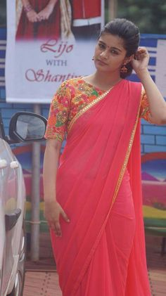 Floral high neck,long sleeve  blouse with plain saree
