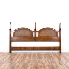 This king sized headboard is featured in a solid wood with a glossy walnut finish. This traditional headboard has woven cane panels, curved trim and intricate carved finial columns. Great for decorating a bedroom wall!  #americantraditional #beds #headboard #sandiegovintage #vintagefurniture