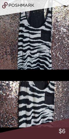 Selling this Zebra printed tank top on Poshmark! My username is: aprestonmua…