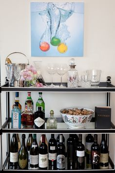 lovee this photograph/artwork above the bar cart!  Phillips deVeer Interiors via houseofturquoise.com