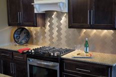 "Want a fun, practical, cheap & eco friendly back splash? Want to re decrorate a boring closet or cupboard?   The peel and stick, 3"" x 6""metal tiles eliminate the need for grout, adhesive and spacers, not to mention the time you save!"