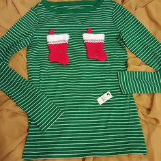Cheeky Tee Christmas NWT Talbots Green w Stockings Cheeky Tee Christmas NWT Talbots Green with thin white stripes and two fuzzy stockings to fill or not in just the right spot!  XS Please note: the stockings cannot be removed.  Shirt must be hand washed and/or spot cleaned. Cheeky Tees Christmas  (this is Talbots) Tops Tees - Long Sleeve