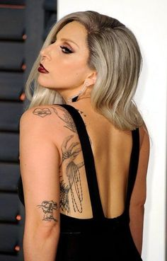 We already know Lady Gaga rocks the scene wherever she goes. Today, let's talk all about Lady Gaga tattoos and their meanings! Tattoo Girls, Girl Thigh Tattoos, Sin City 2, Fan Tattoo, Lady Gaga Nose, Famous Celebrities, Celebs, Celebrities With Tattoos, Female Celebrities