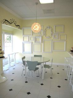The frames on the wall and the floor are sooooo cute! Just imagine with a mint green wall.