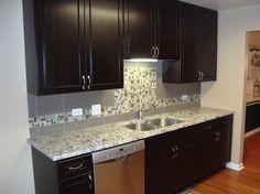 Coastal contemporary condo kitchenblack granitependant