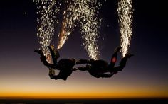 A group of crazy skydivers have taken their extreme hobby to the next level by setting off fireworks as they jump out of the plane. Pyrotechnic skydiving is the latest wild craze in extreme sports. A team of four divers activate sets of fireworks strapped to their legs as they fall through the air of speeds of up to 120mph.