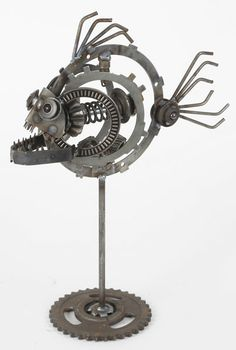 Large Piranha - mechanical steampunk style metal sculptures made from recycled engine and transmission parts. Engine-New-Ity / Richard Kolb