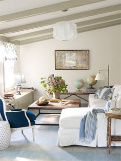 Home Makeover Ideas - Before and After Home Makeovers - Country Living After: Family Room  In a renovated family room, new window seats also function as storage for blankets and toys. A sectional sofa by Mitchell Gold + Bob Williams mingles with a denim-upholstered Hickory Chair seat and a coffee table from ABC Home.