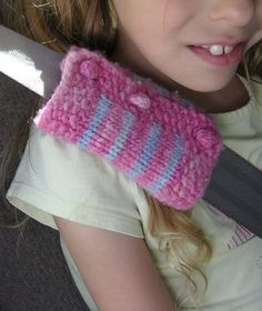 Free Knitting Pattern for Seat Belt Cozy - A simple cozy to cushion the feel of the seat harness and keep it from digging into skin. Fastened with bobble buttons. Designed by Chris Behme. Pictured project by CoriInKansas