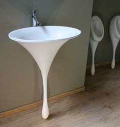 This organic form is the solid resin 'spoon sink'-the sister product the award winning spoon urinal-which mimics the shape of a single teard...