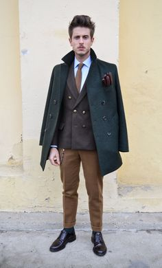 Shop this look for $514:  http://lookastic.com/men/looks/dress-shirt-and-tie-and-gloves-and-double-breasted-blazer-and-pea-coat-and-dress-pants-and-derby-shoes/3291  — Blue Dress Shirt  — Brown Tie  — Burgundy Leather Gloves  — Dark Brown Double Breasted Blazer  — Dark Green Pea Coat  — Brown Wool Dress Pants  — Dark Brown Leather Derby Shoes